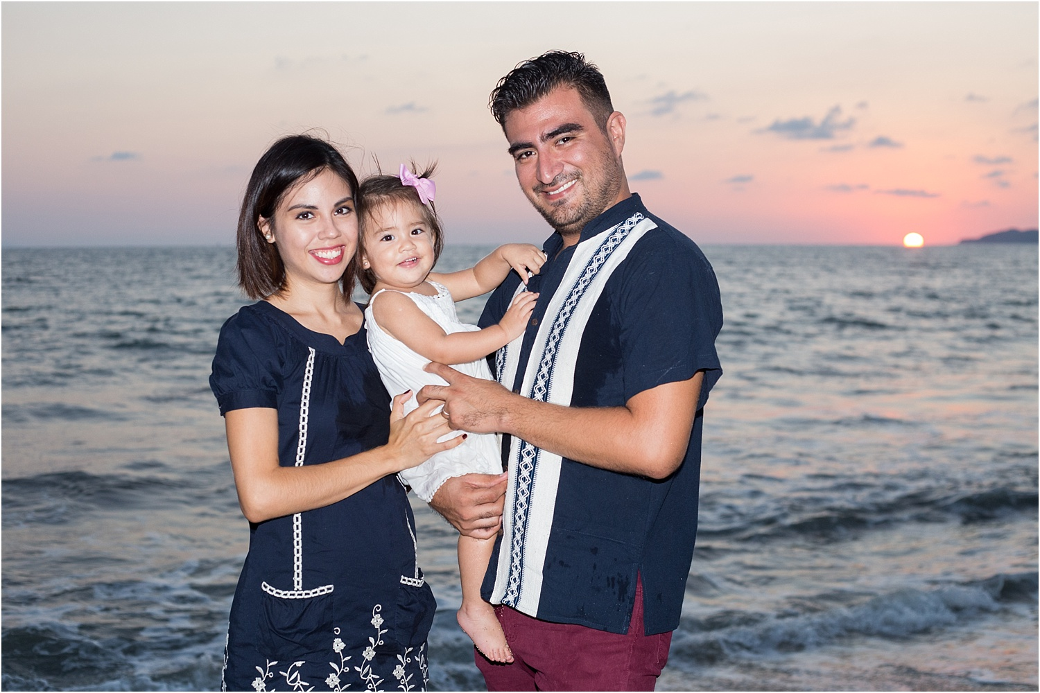 portrait of young family by the water - Using Flash for Beach Portraits