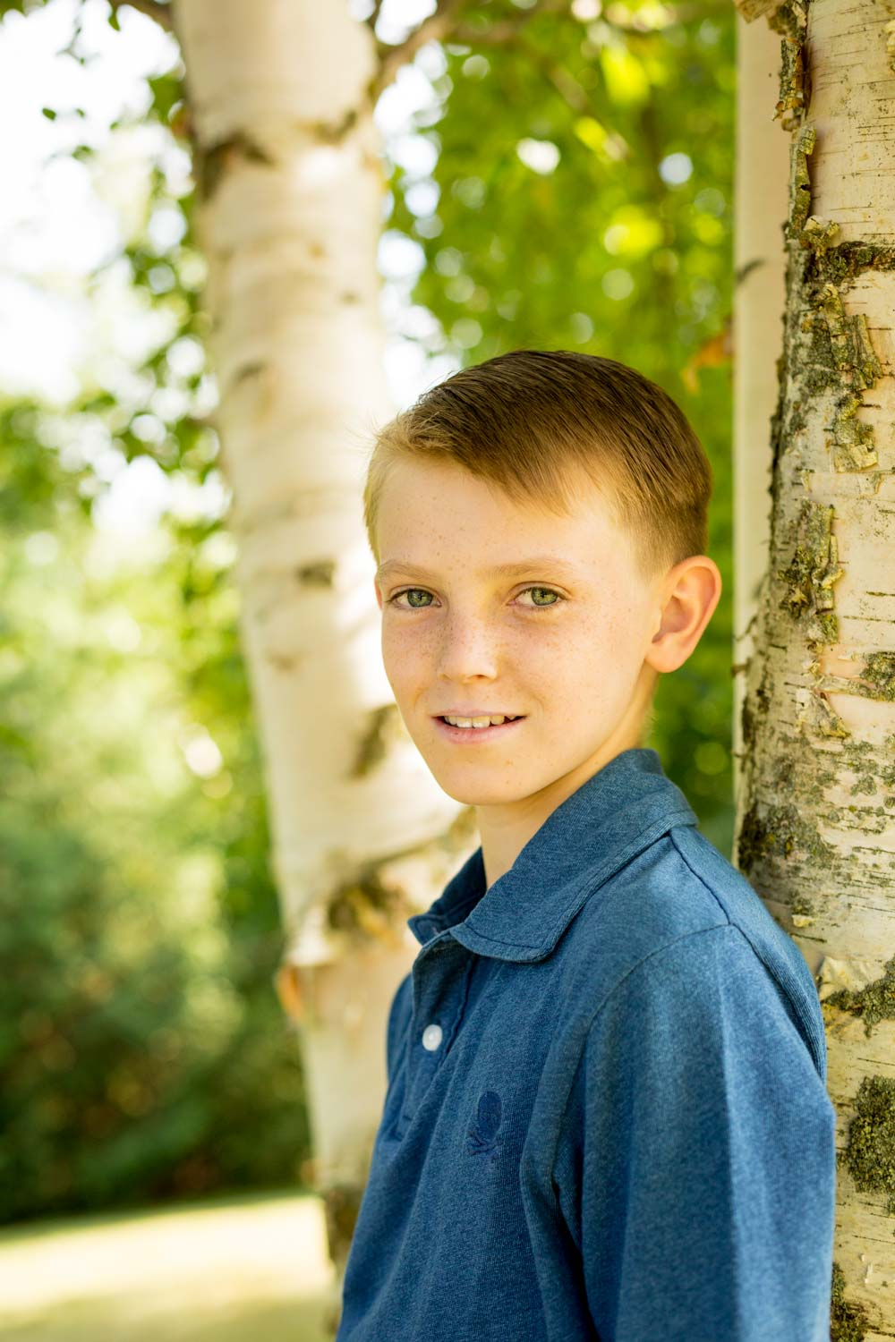 portrait of a boy by a tree - Tips for Preparing for a Portrait Session