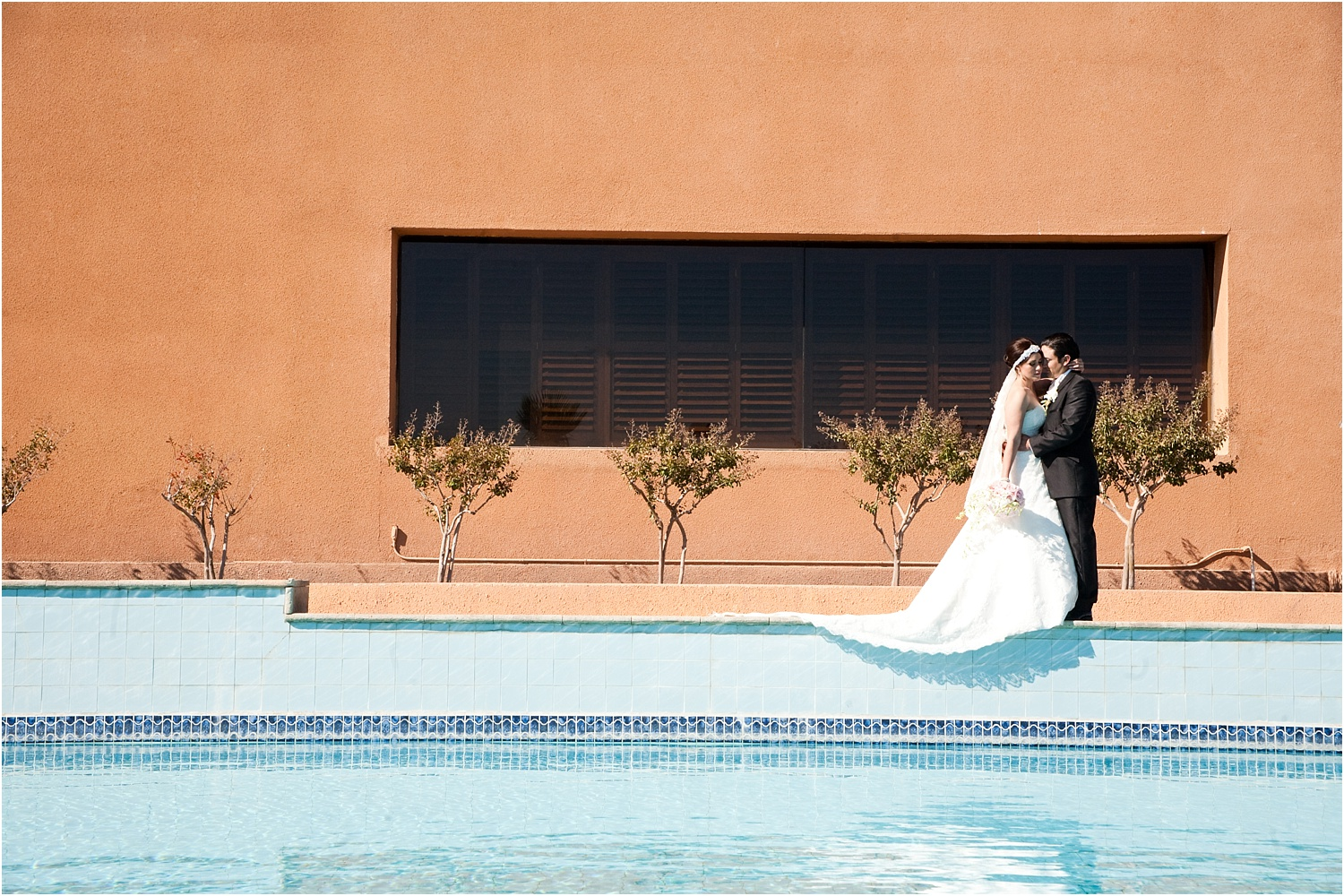newlyweds poolside - How to make Portrait Photography in Bright Midday Sun.