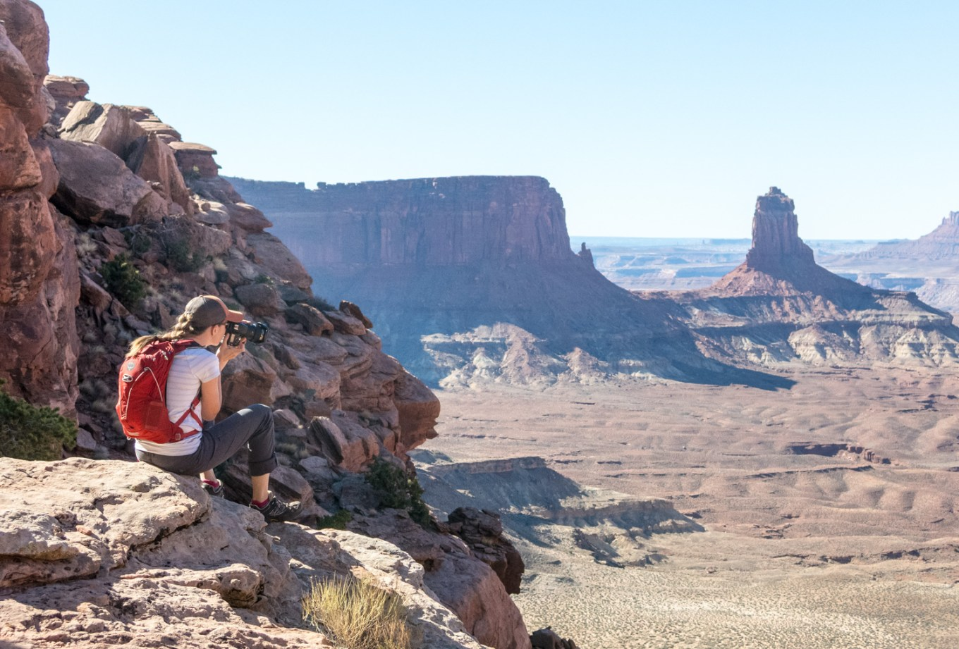 Batteries and Backups: How to Shoot Off the Grid - photographer shooting in a canyon