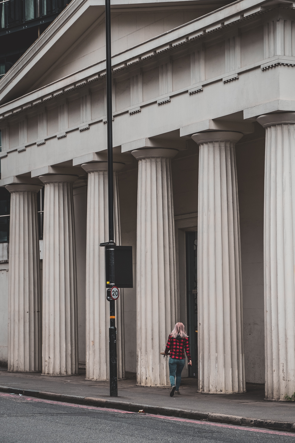 Image: I liked this pop of red in the shirt against the subdued tones of the building. Unidentifiabl...