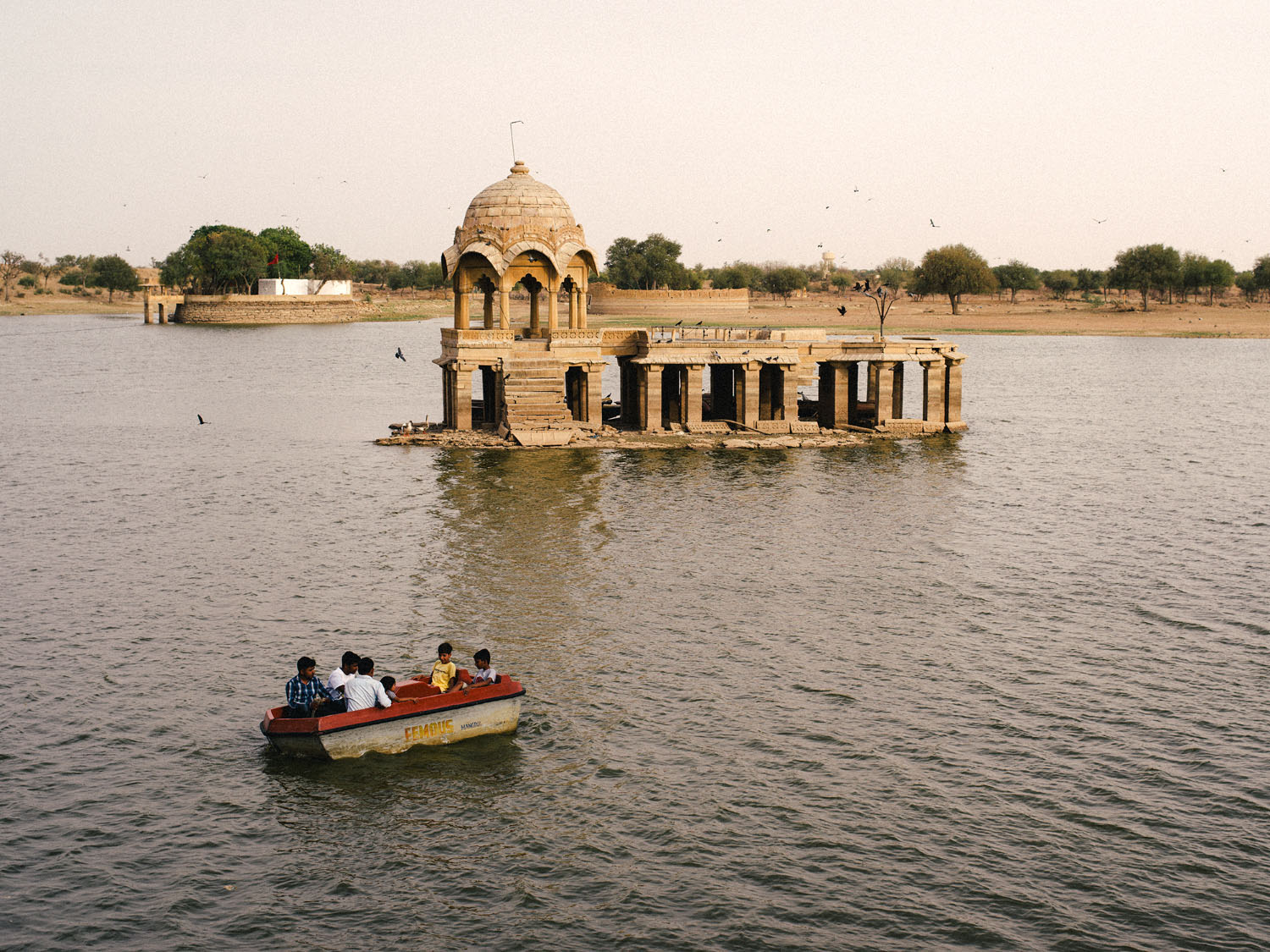 tourists on a boat in India - 7 Tips to Make Travel Photography Interesting Again