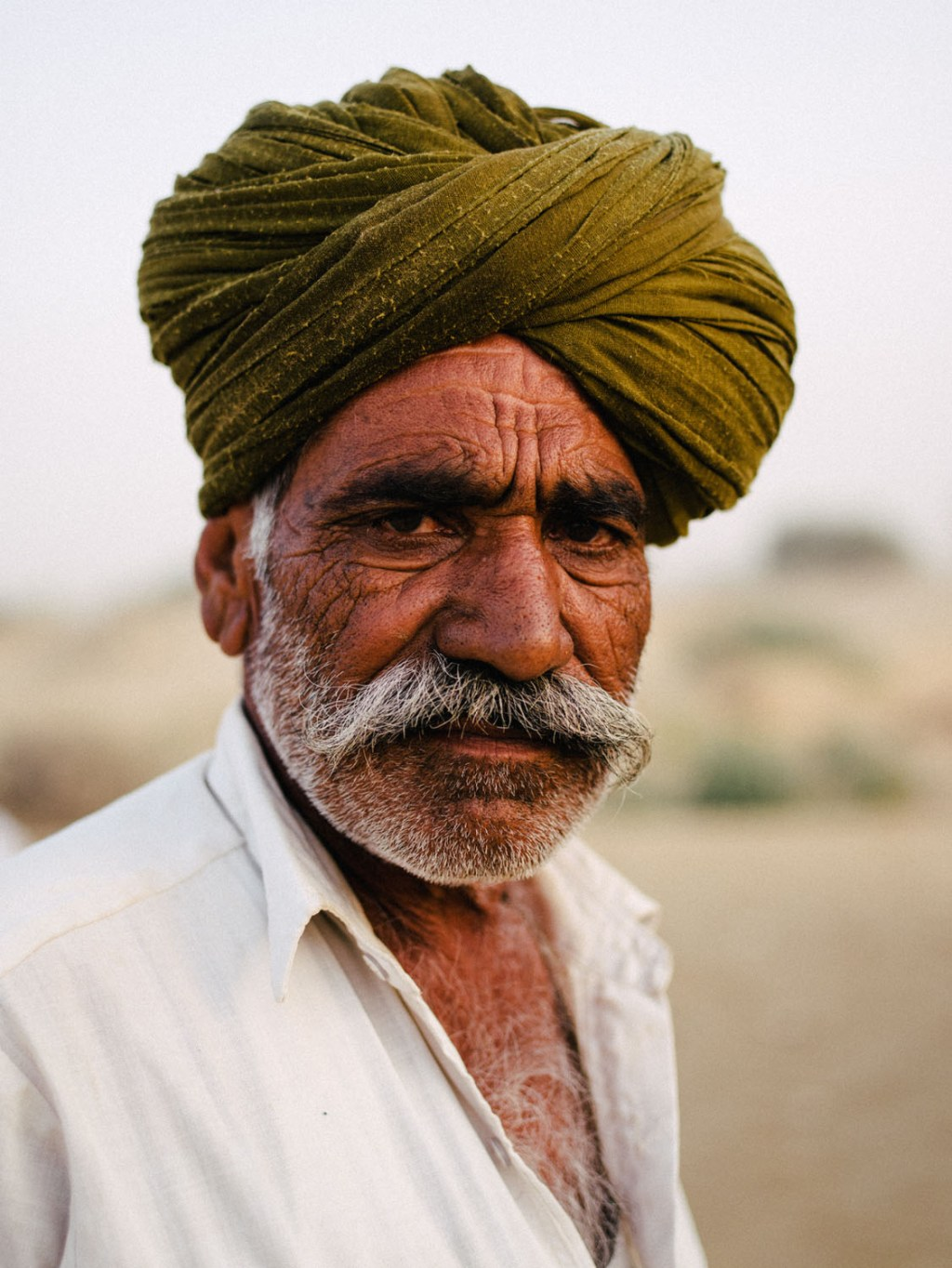 Portrait Indian man - 7 Tips to Make Travel Photography Interesting Again