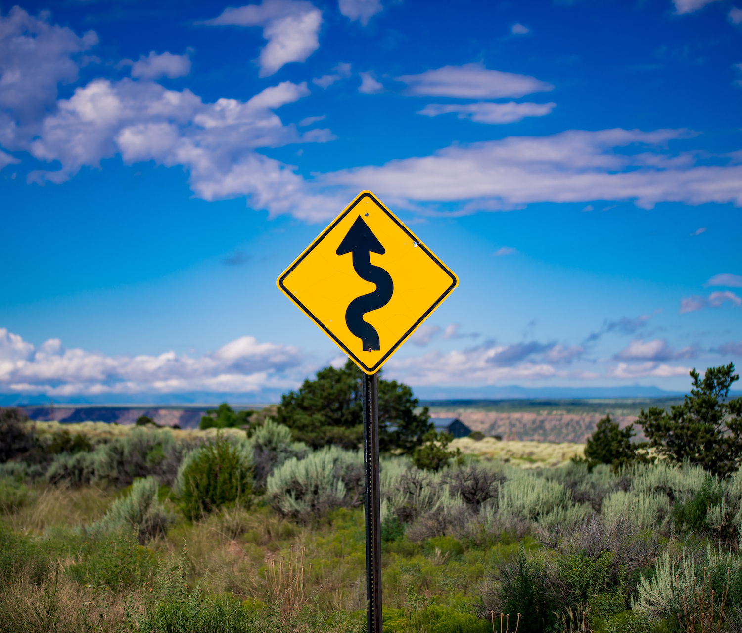 Road trip photography tips - curves in the road sign