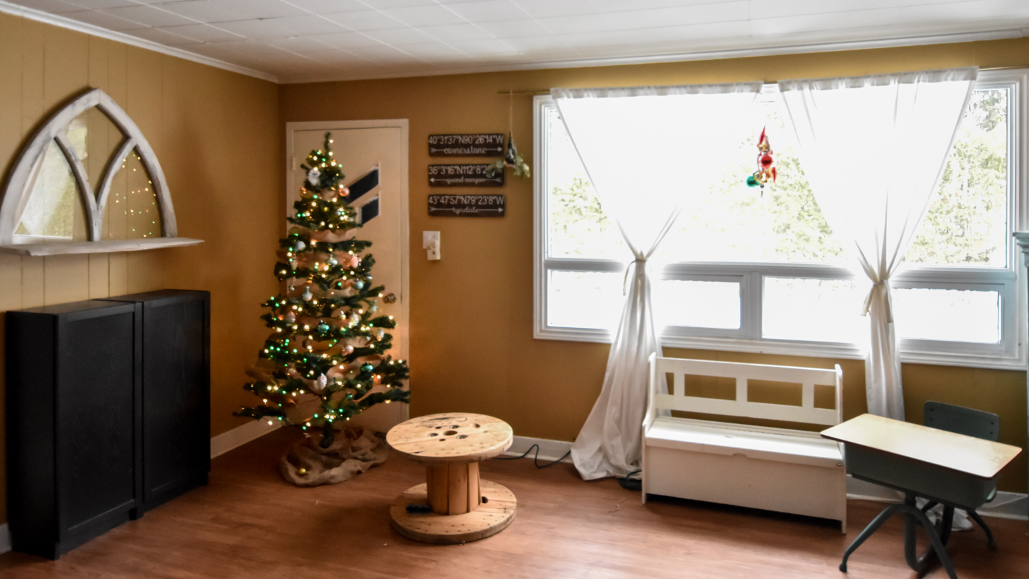 Image: Here the tree is tucked into a dim corner so the lights can glow. The kids will sit on the st...