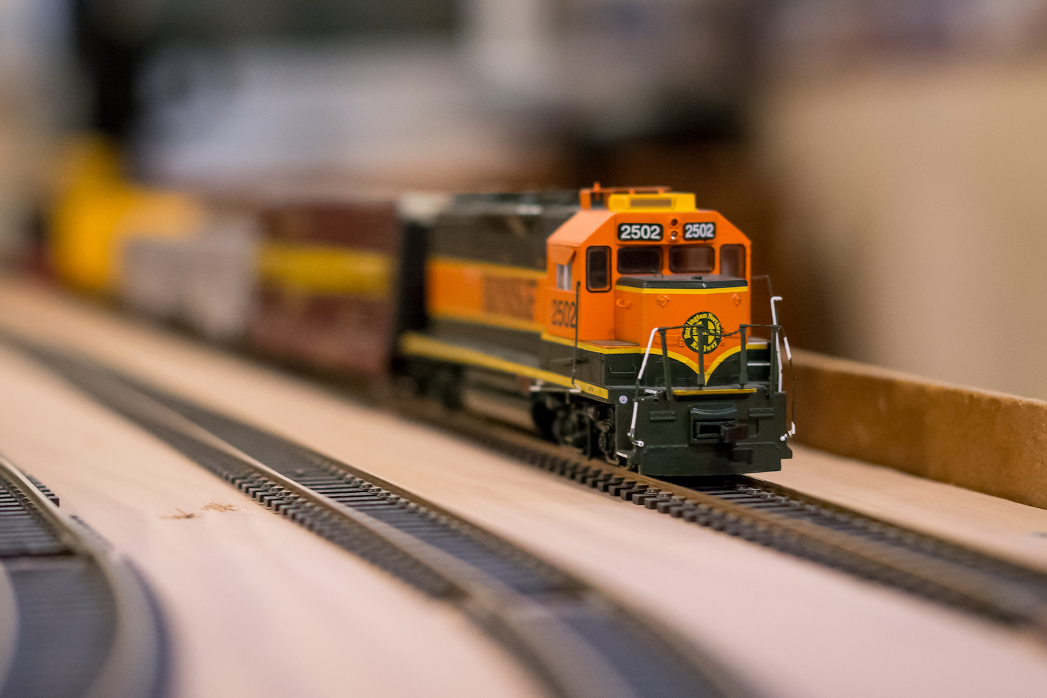 Image: Model train in a dim basement, shot at 50mm, f/2.8, 1/60 second, ISO 3200.