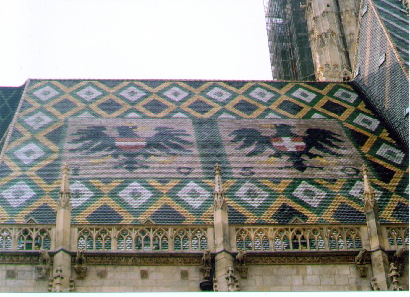 Image: Clearly the focus of the image is the roof tiling and the eagles. Area's to the top and...