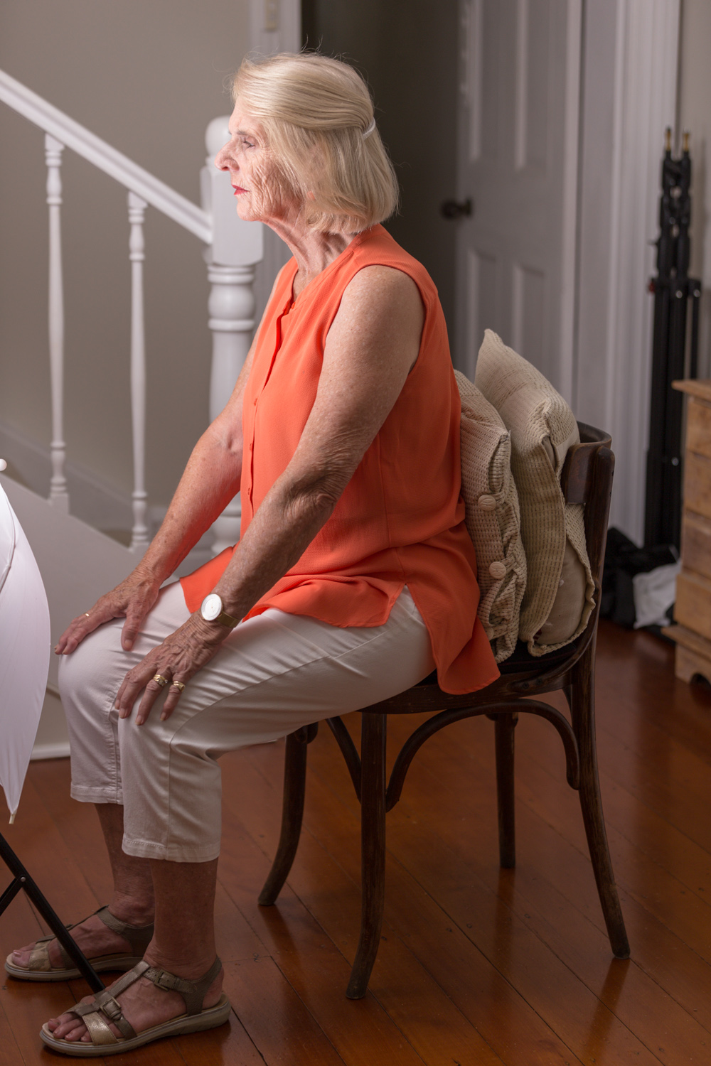 Image: Move your subject as close to the edge of the chair as is safe while supporting their back. C...