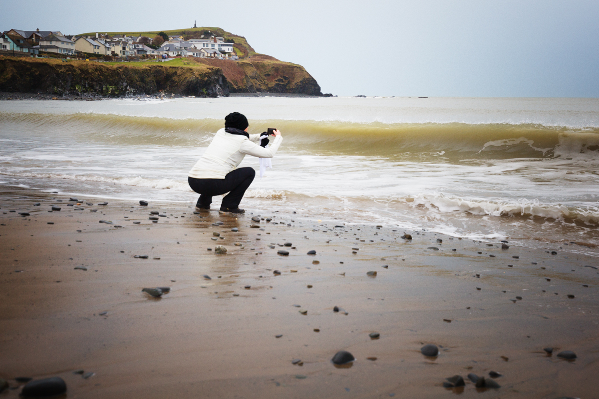 Image: My goal was to capture my friend as she took photos of the incoming waves on the beach in Bor...