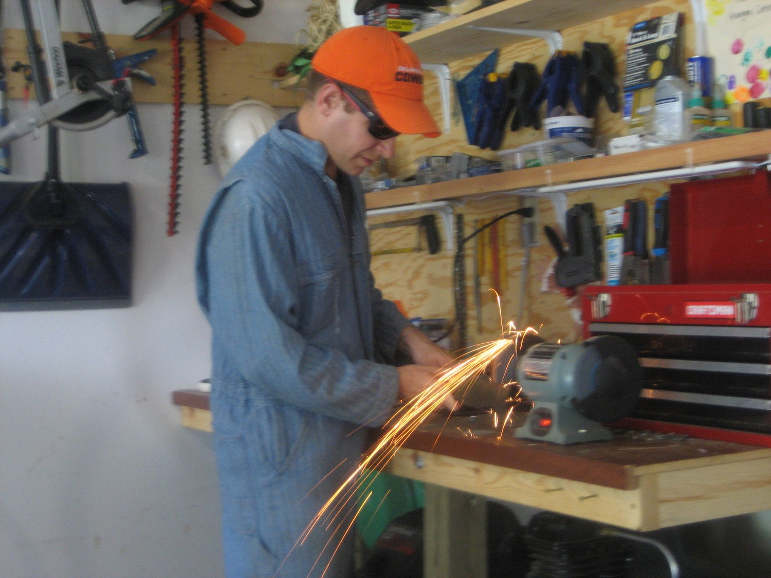 Image: My son took this picture of me sharpening a lawnmower blade. He used a night-time mode which,...