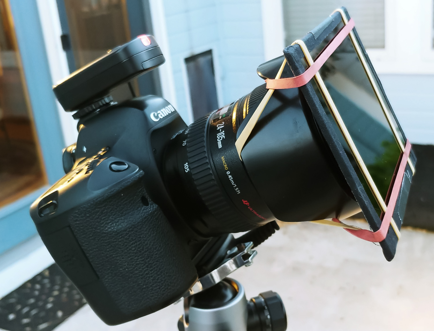 Image: It's funky, but it works. Reverse the lens hood and use rubber bands to attach the weld...