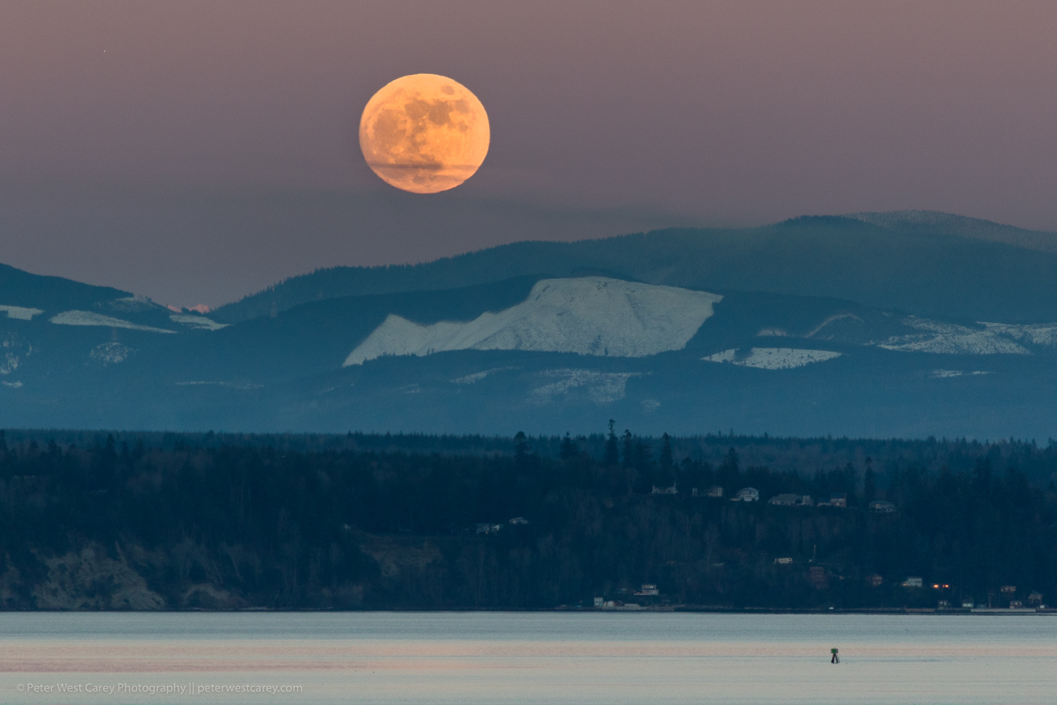 Image: Full moon rising above Washington's Cascade Mountains and Puget Sound