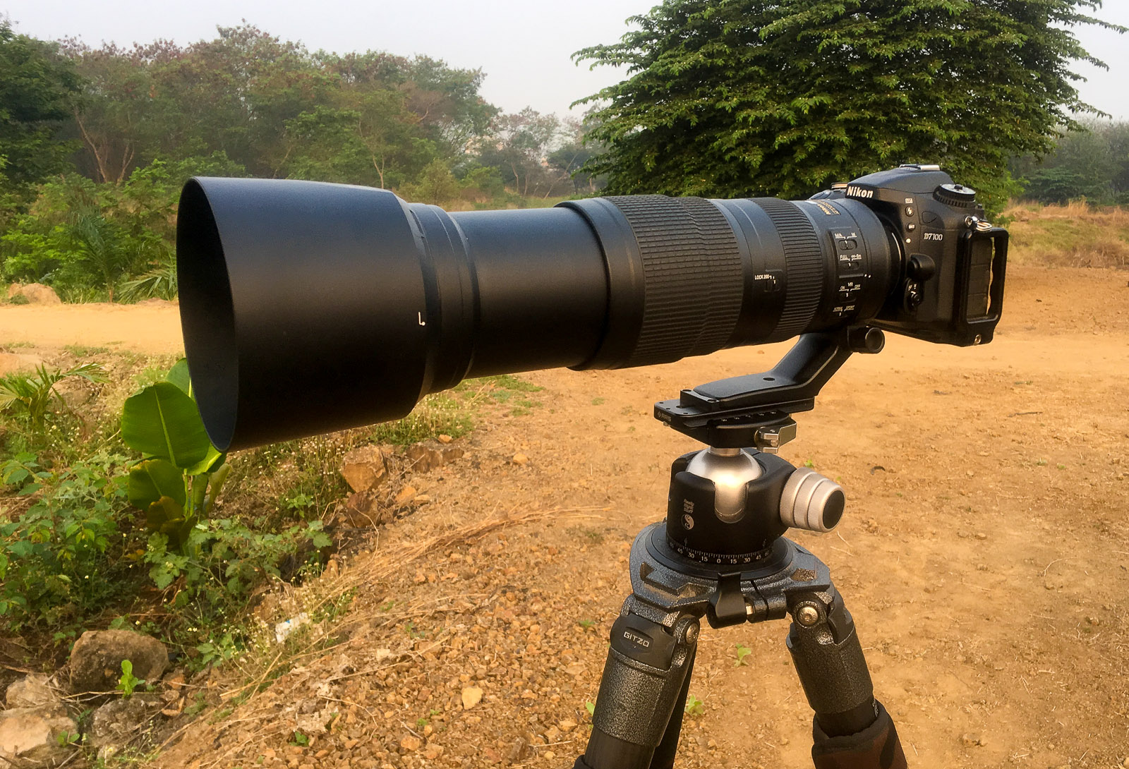 Image: Nikon 200-500 f/5.6 lens mounted on a camera, zoomed to 500mm