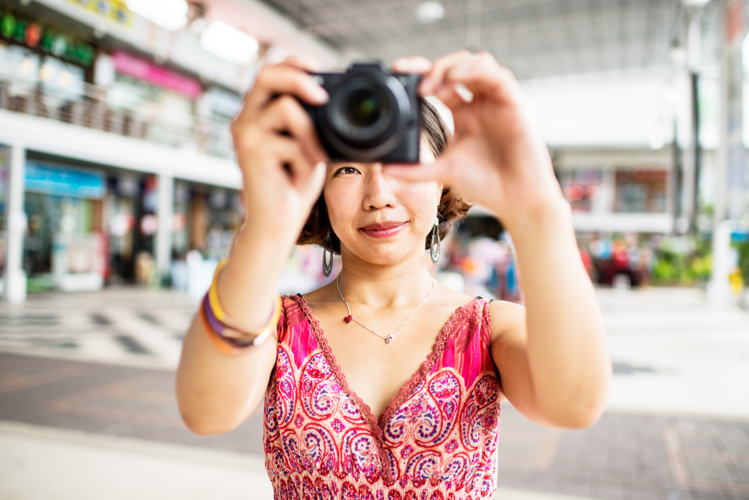 Understanding Exposure Metering Modes Woman Photographer at the Shopping Mall