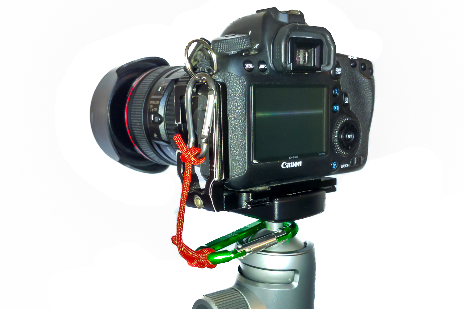 Image: A simple DIY camera-to-tripod safety tether as outlined here. The top knot is a clove hitch,...