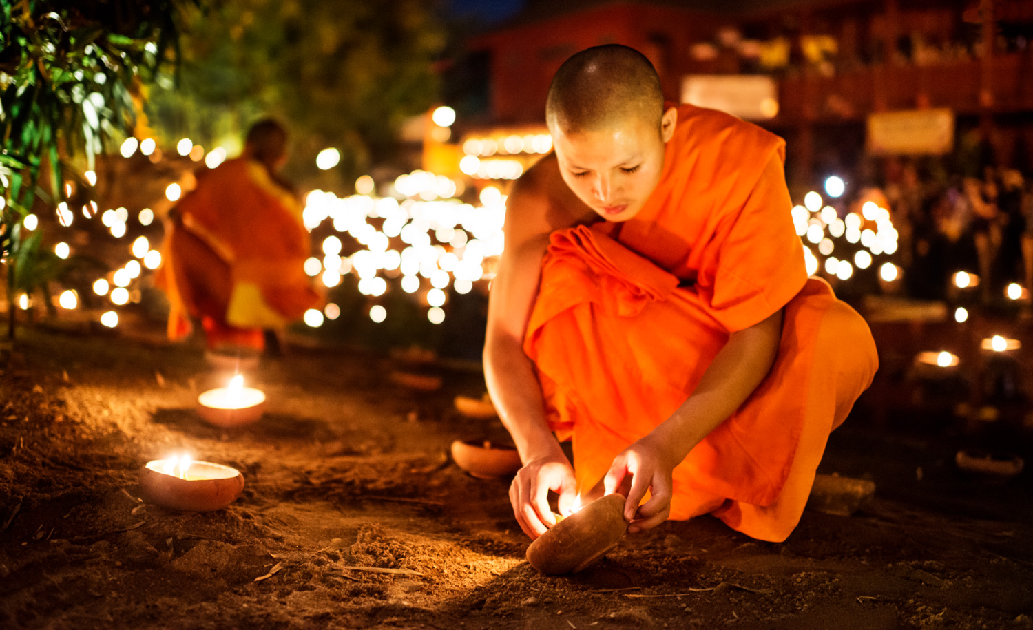 Monks Lighting Candles at night