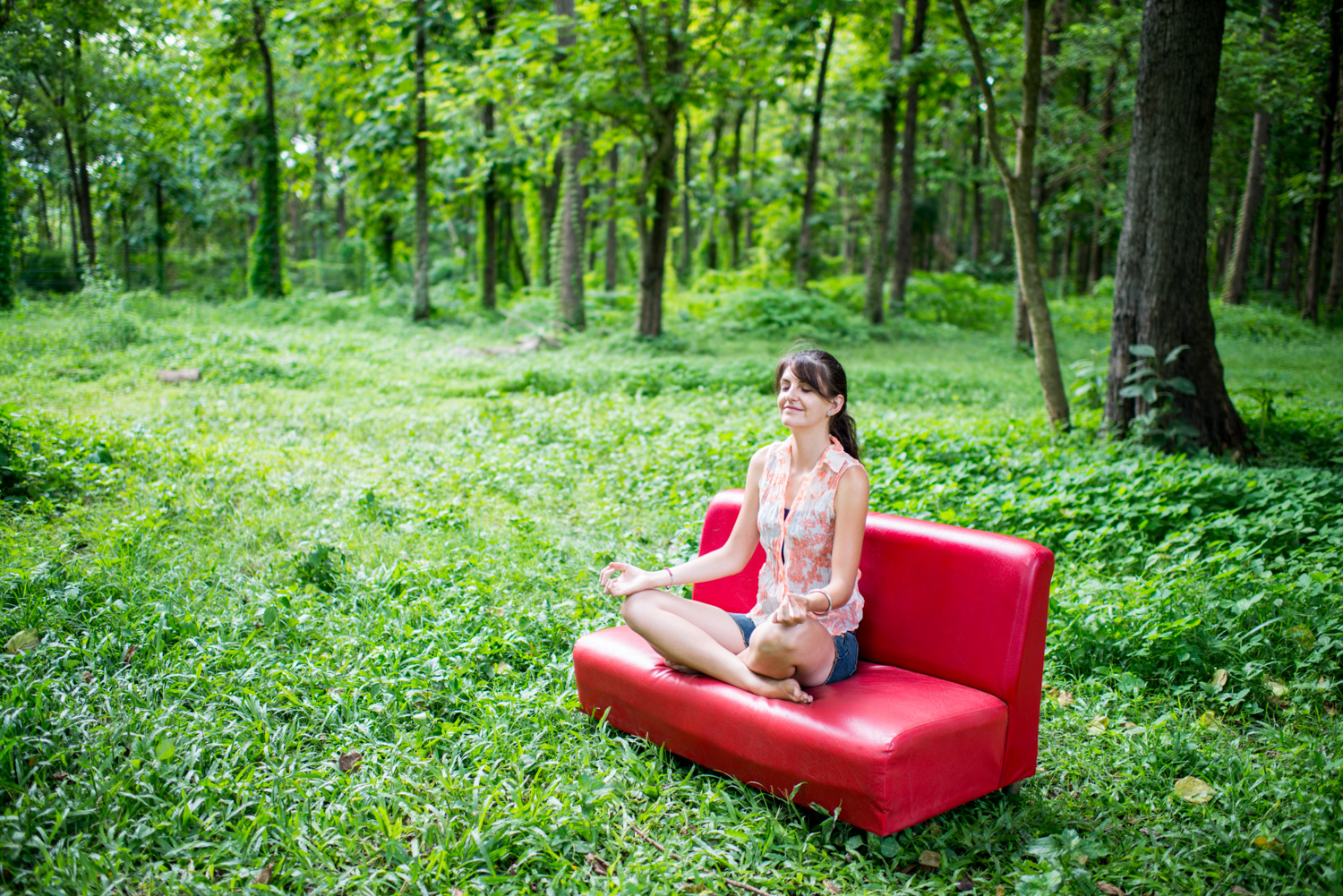 Woman in a red sofa outdoors manual exposure cheat sheet