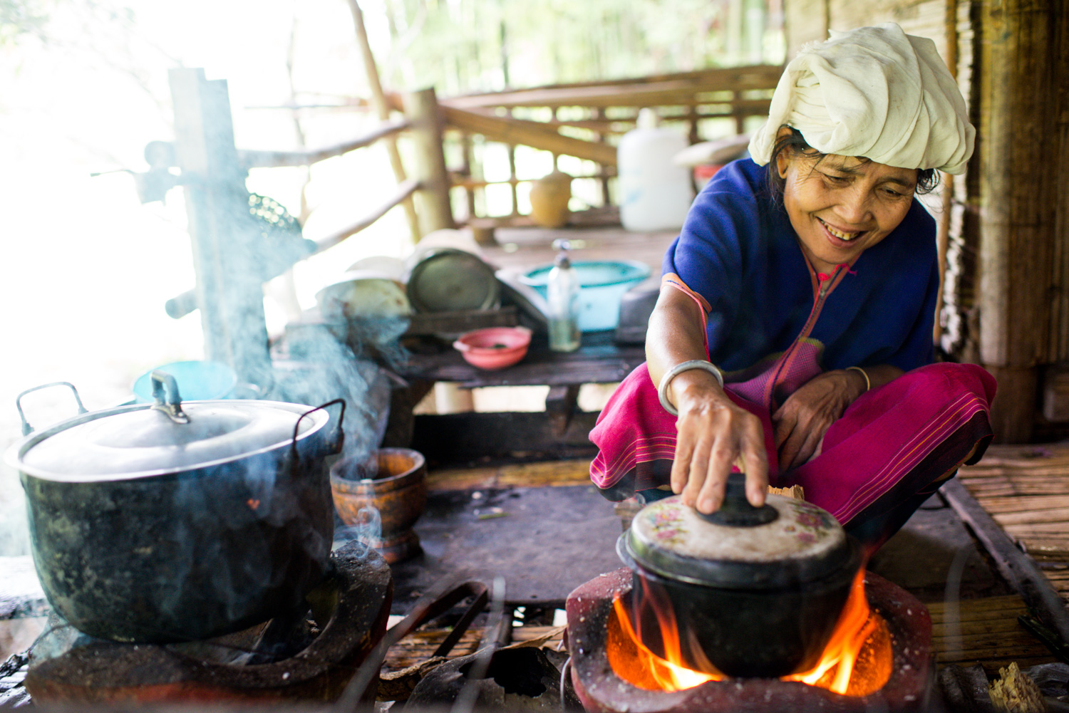 Karen woman cooking for environmental travel portraits