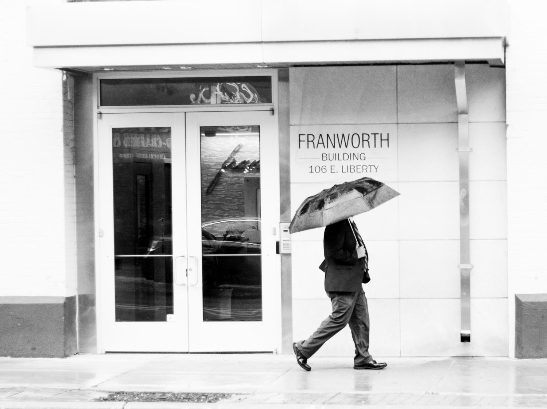 man hidden by umbrella