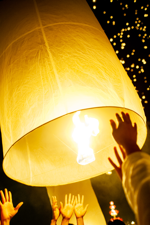 launching a sky lantern during Loi Krathong festival in Thailand