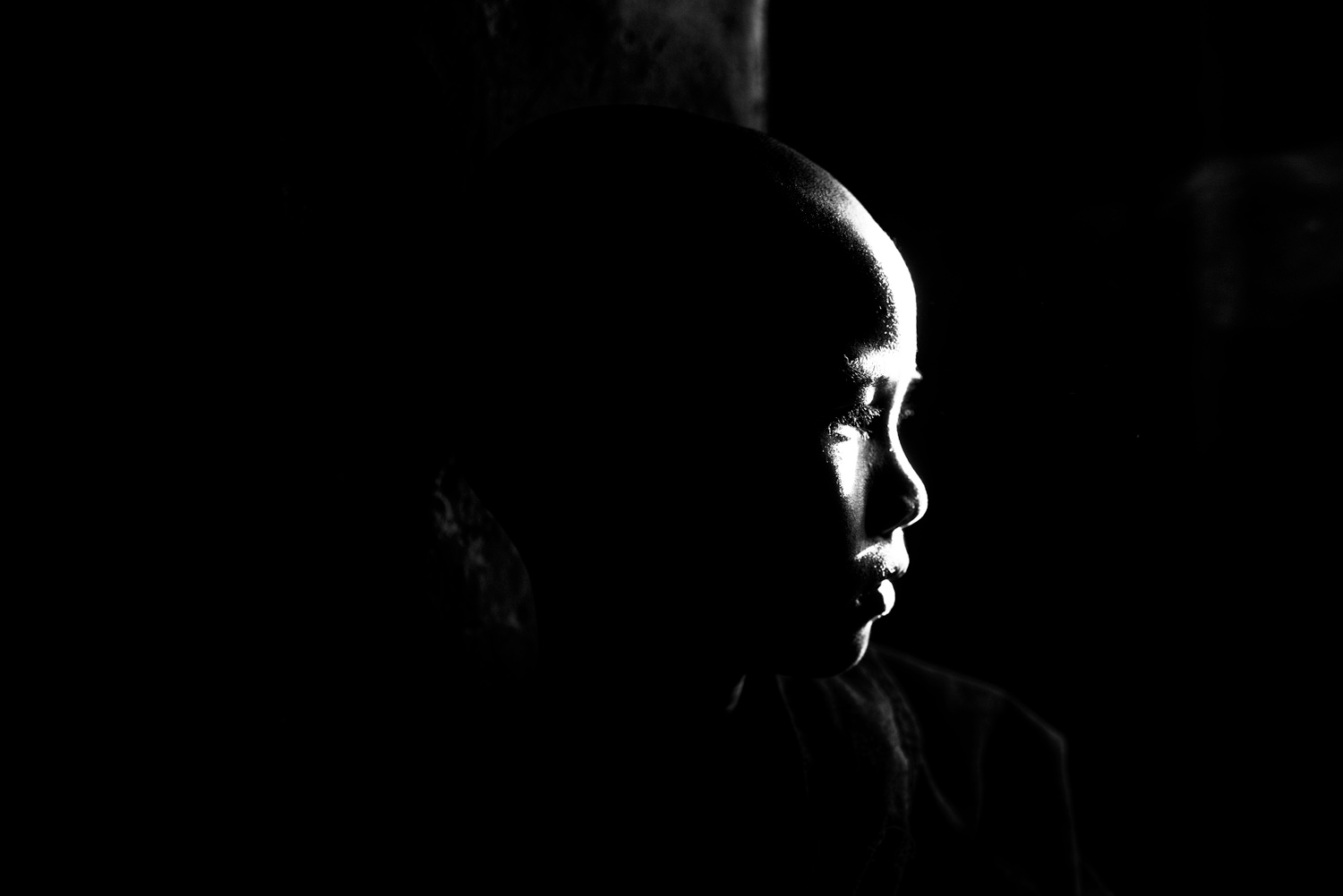 portrait of a novice monk, high contrast black and white