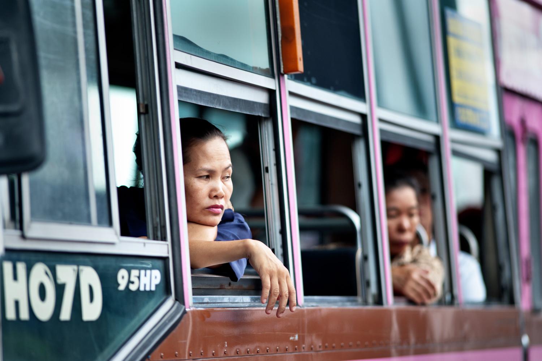 woman framed by bus window