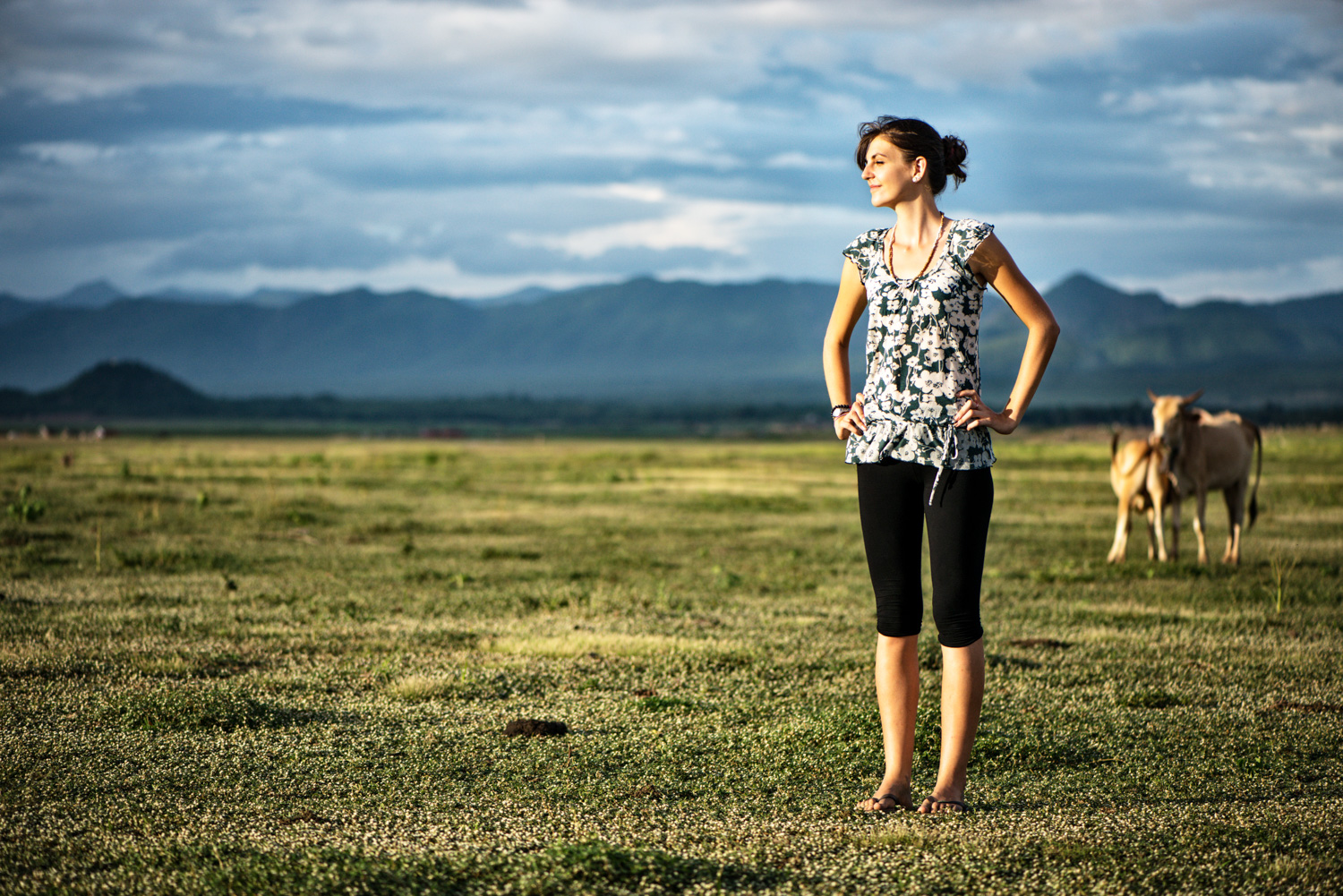 woman out standing in a field for cropping photos