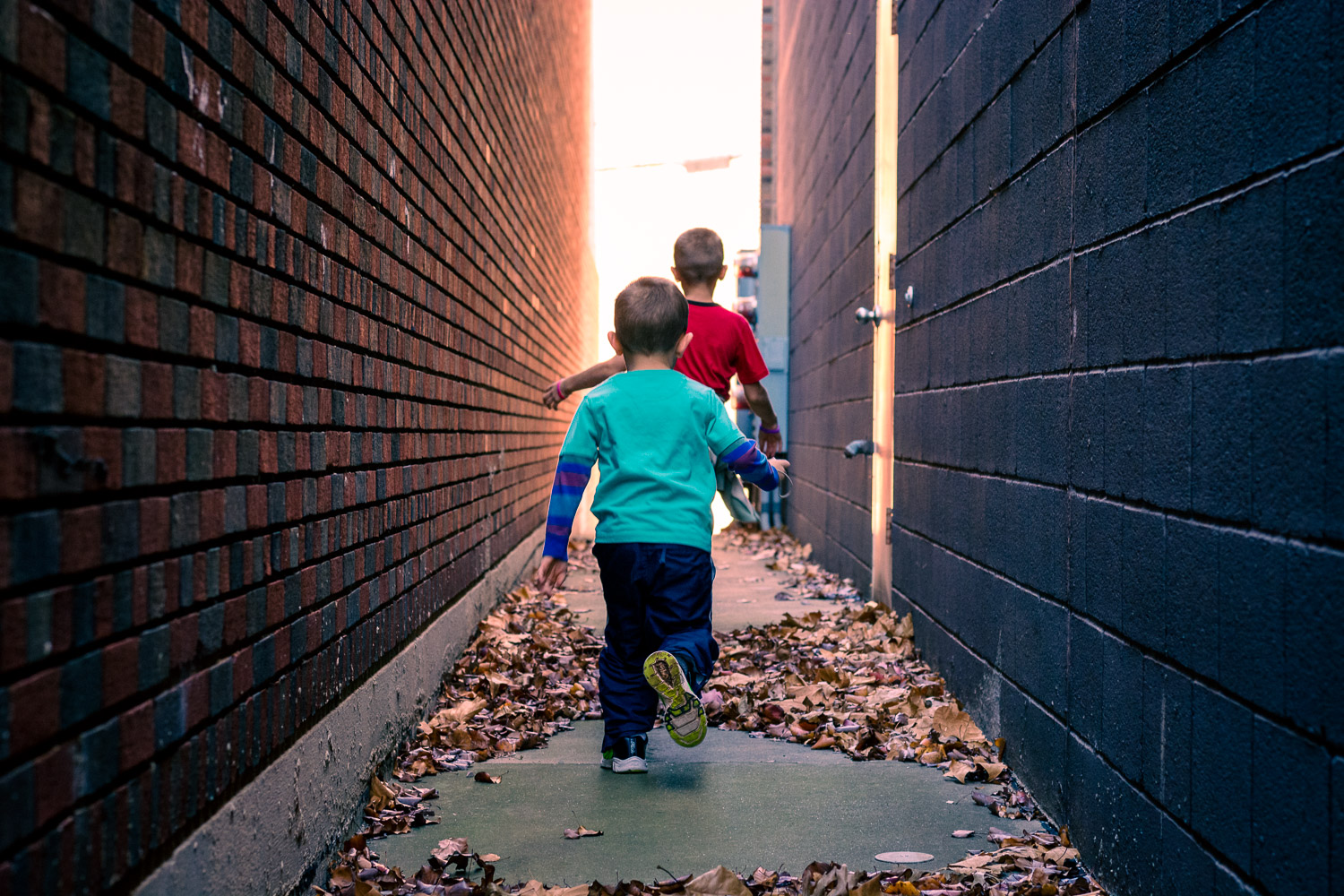kids running in an alley