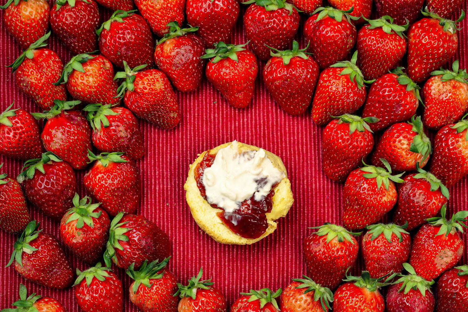 strawberries framing the food in the center