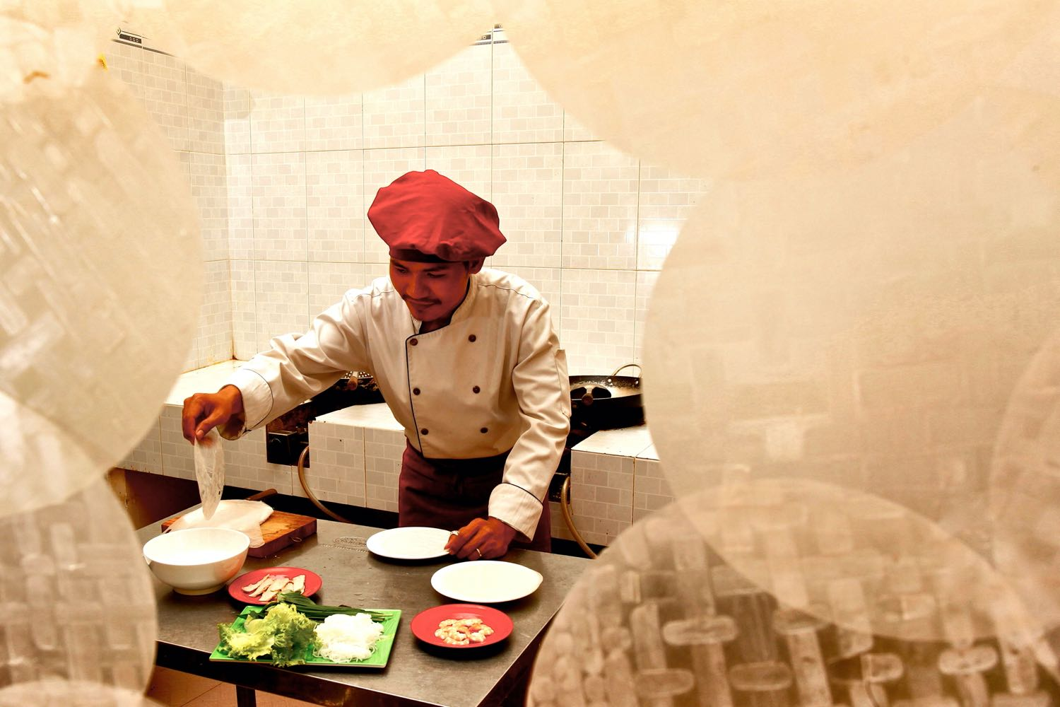 a chef framed by rice paper