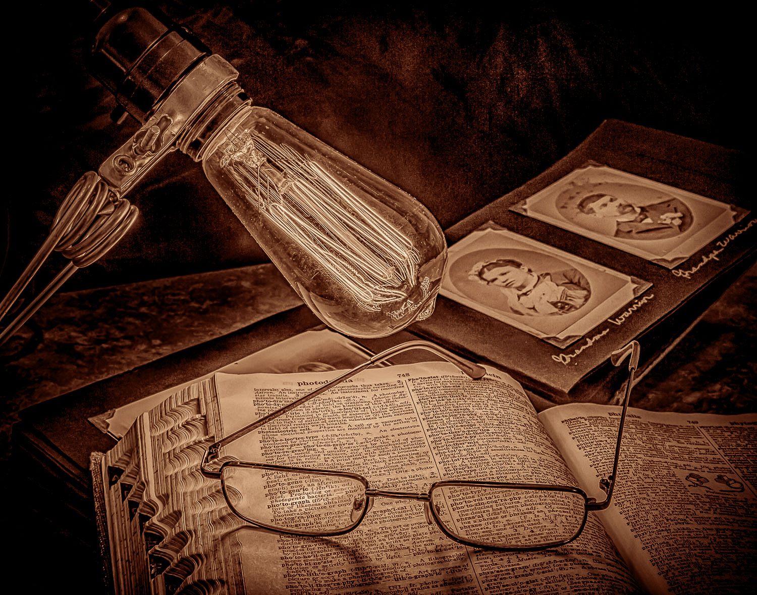 black and white still life photography light and old book