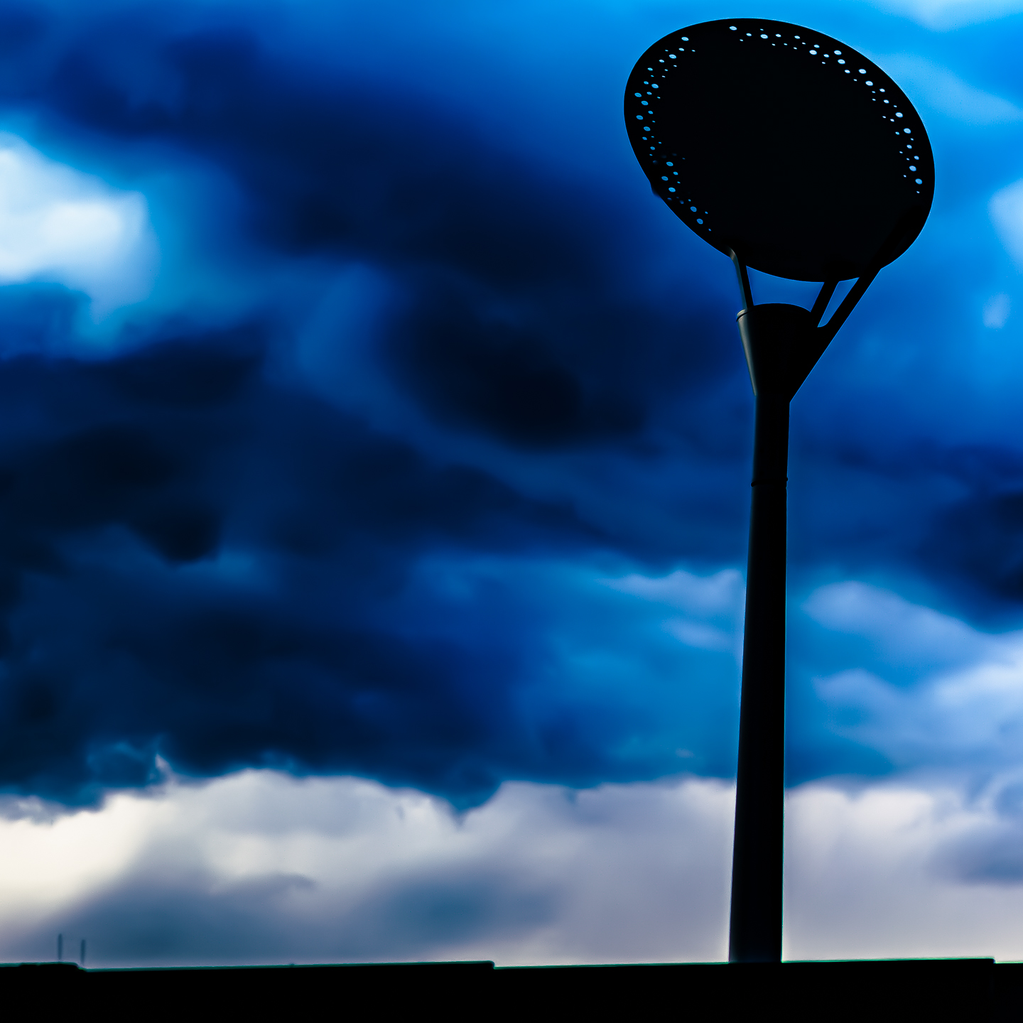 pole and dark clouds