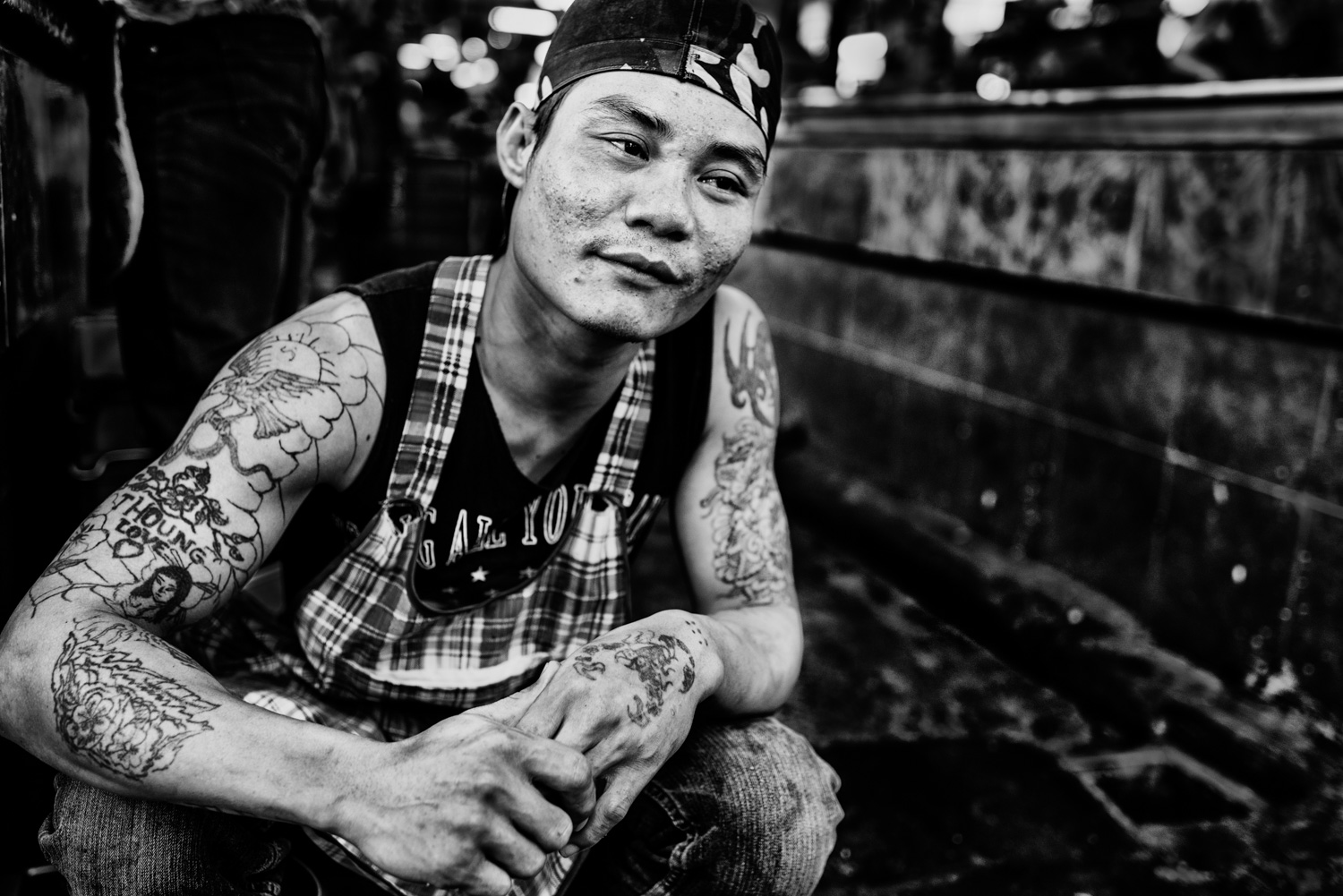 Black and white street photography portrait of a tattooed man. © Kevin Landwer-Johan.