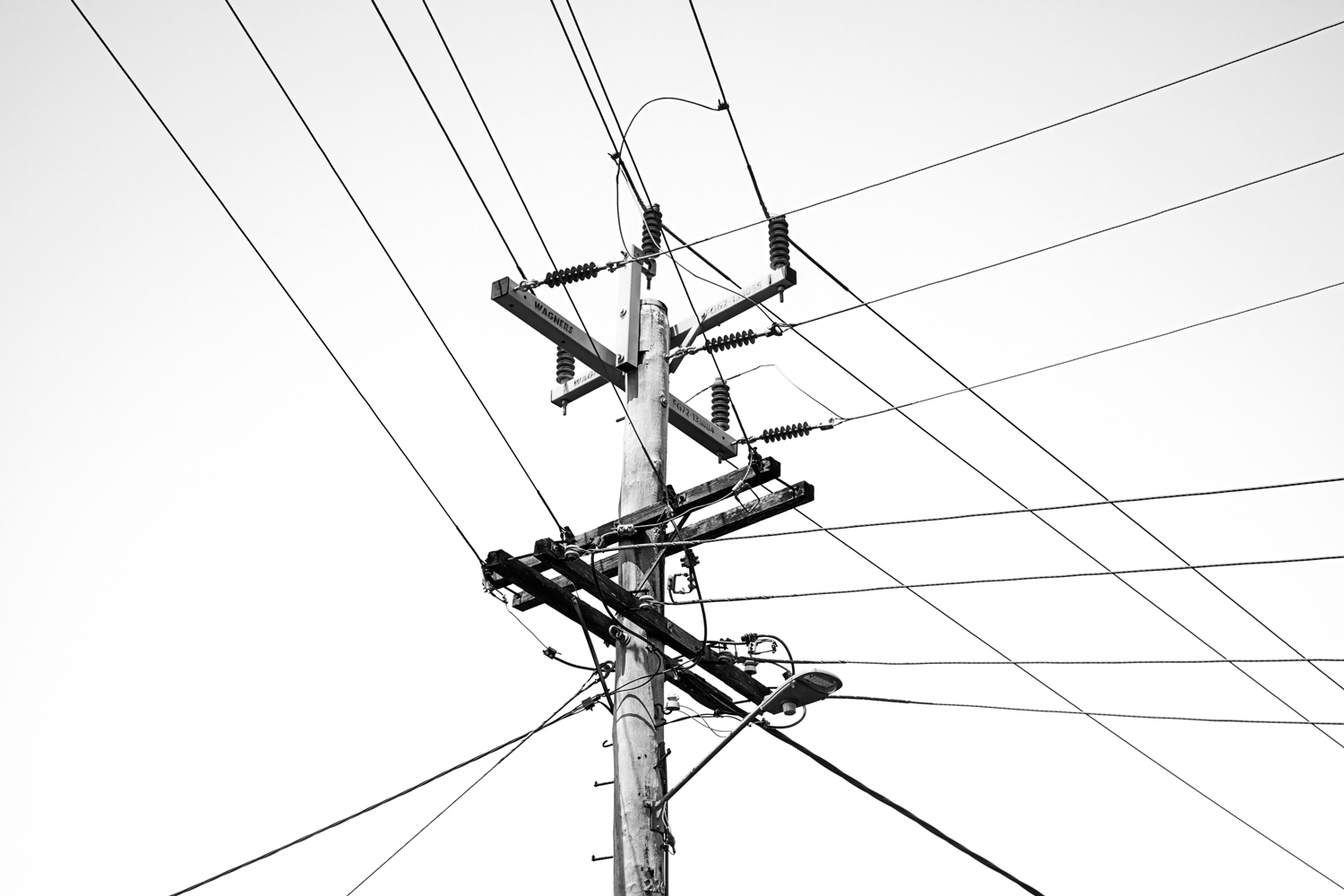 A utility pole with triangle composition