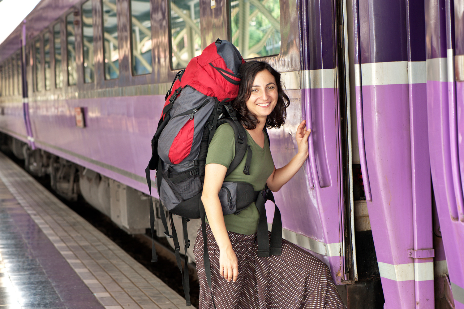 woman with a backpack getting on a train photo essay ideas