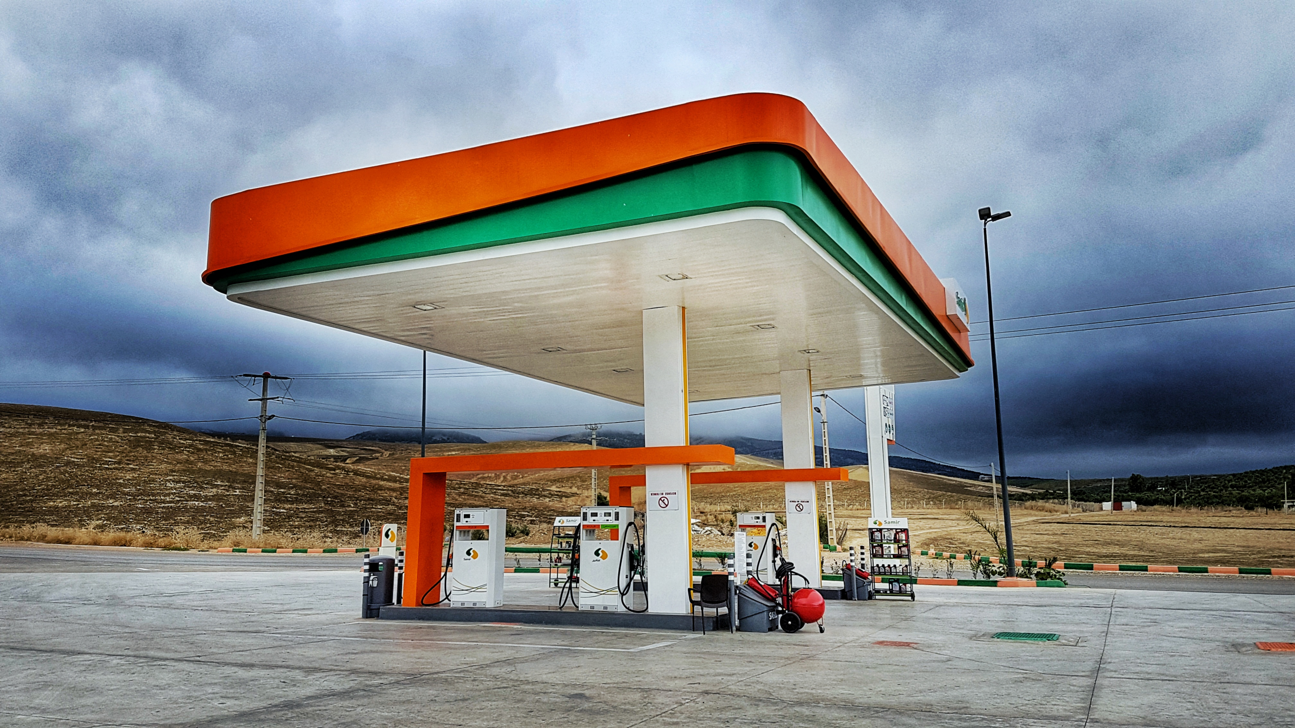 gas station with moody clouds