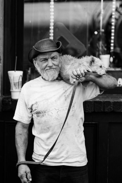 man with dog candid photography tips