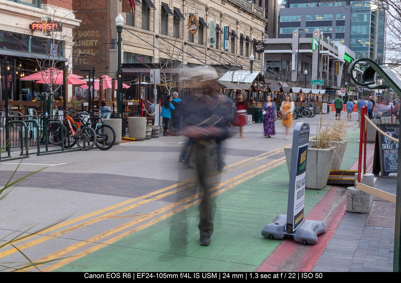 man walking near street long exposure