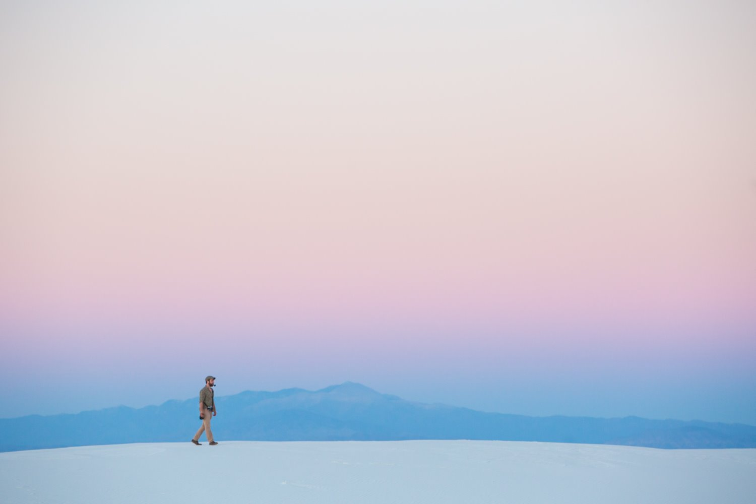 man walking in minimalistic landscape photography composition