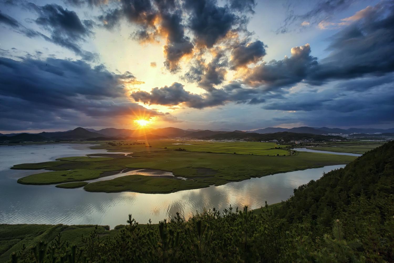 sun rising over the landscape