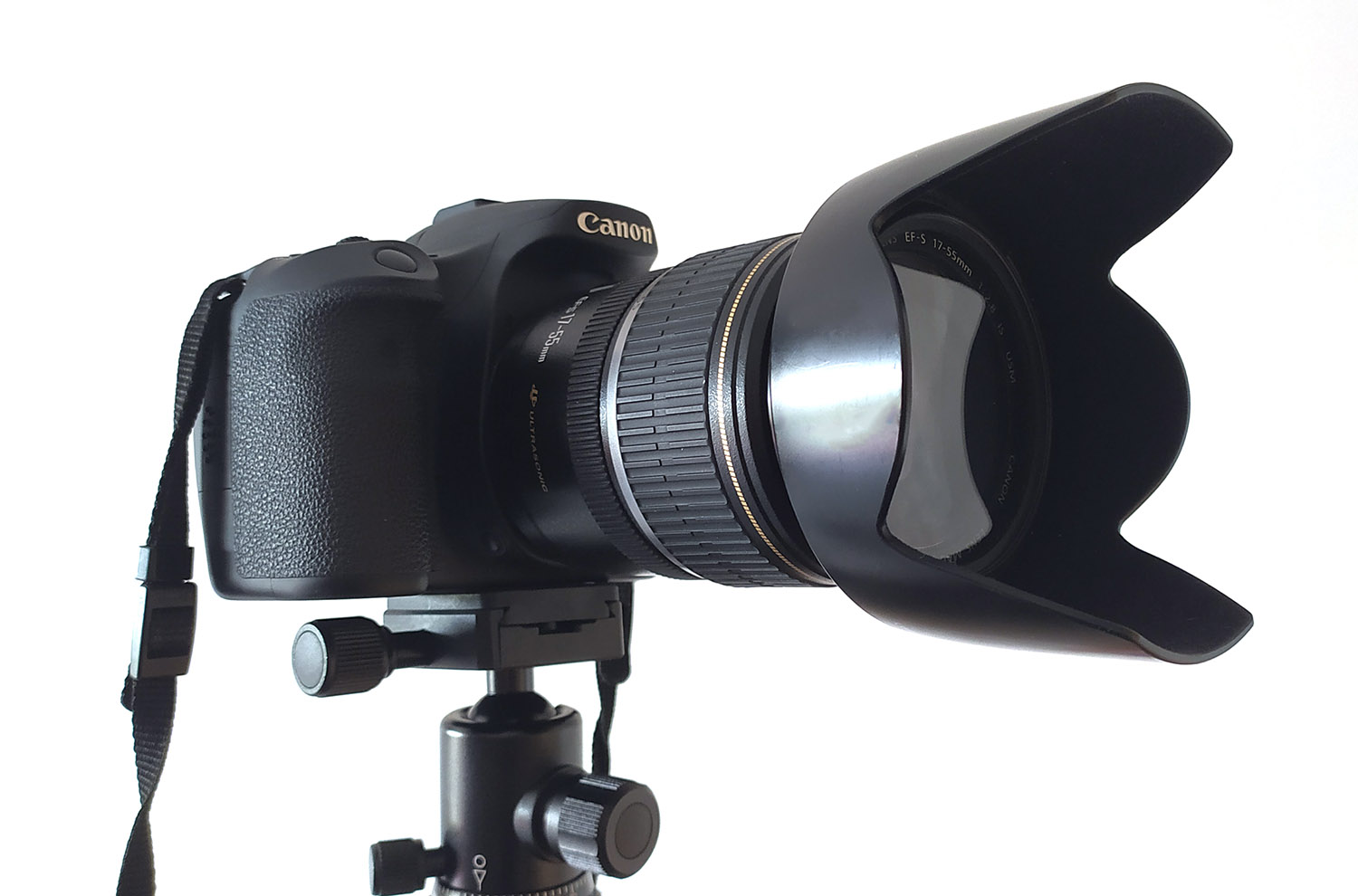 Canon camera on a tripod with a lens hood