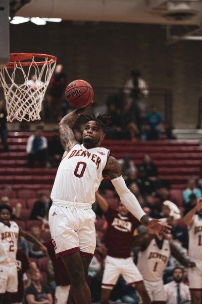 man dunking a basketball