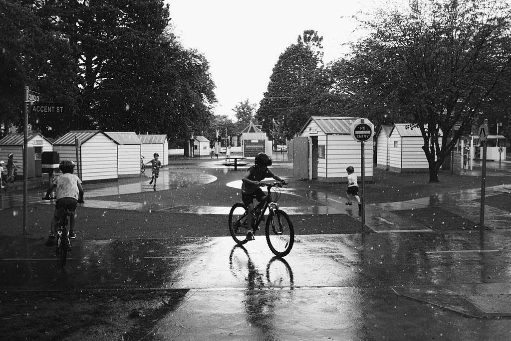 Kids Riding in the rain