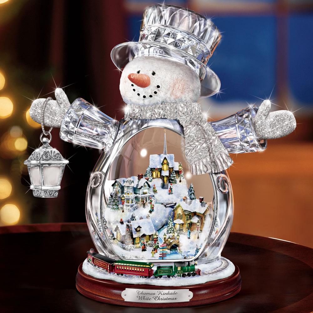 The Thomas Kinkade Illuminated Crystal Snowman Hammacher
