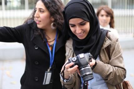 UNDPI Media Trainees, Malak & Shireen practice photography skills.