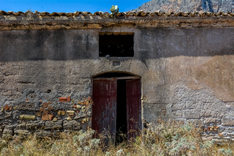 ruins tuna factory fishing san vito lo capo tonnara del secco abandoned urbex lost places italy sicily courtyard interior storage