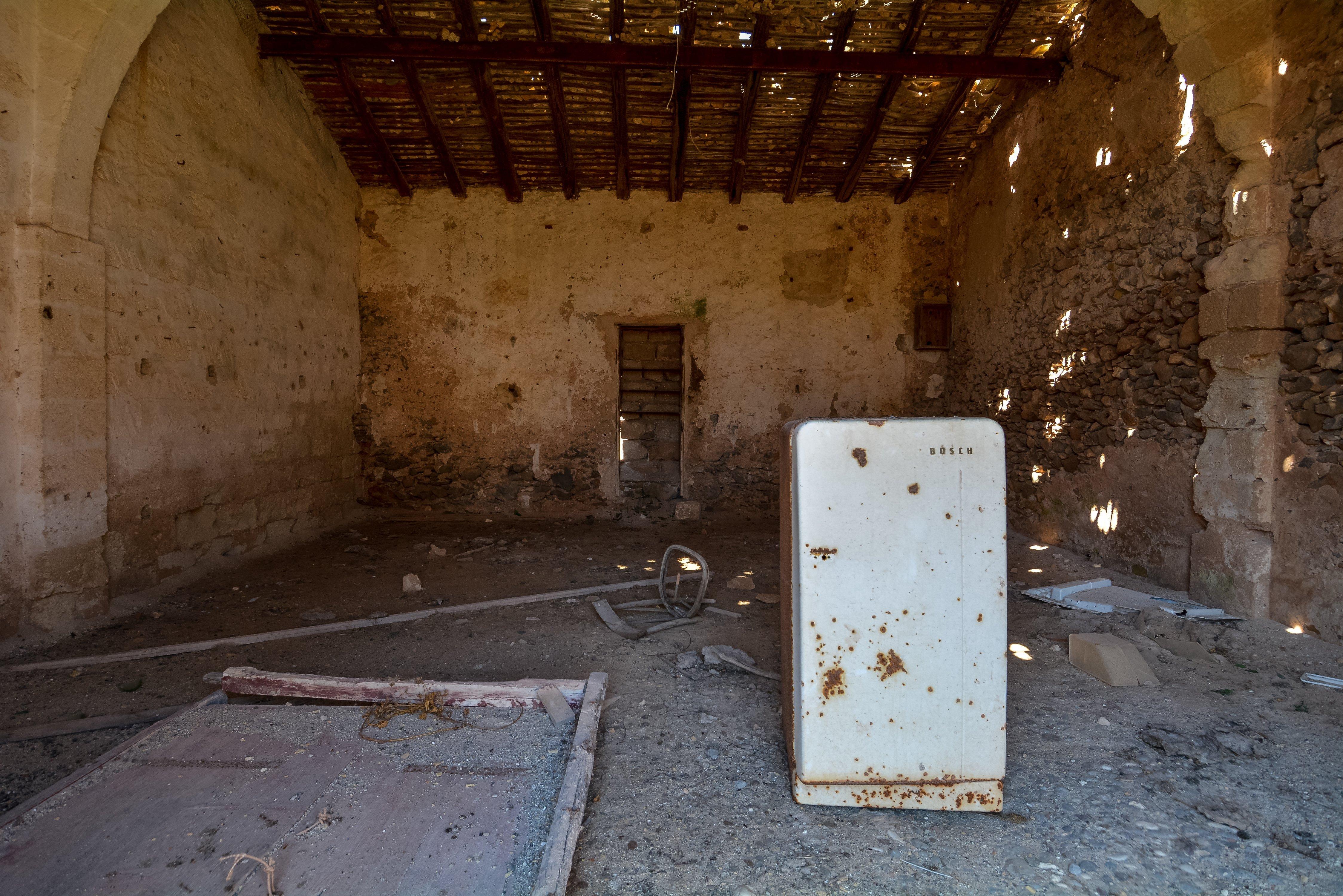 ruins tuna factory fishing san vito lo capo tonnara del secco abandoned urbex lost places italy sicily courtyard interior trash refridgerator