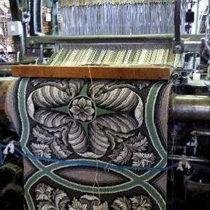 The Brussels weave carpet on the loom in Kidderminster, England.