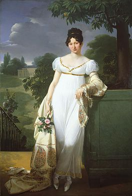 An example of an empire silhouette dress and slippers.