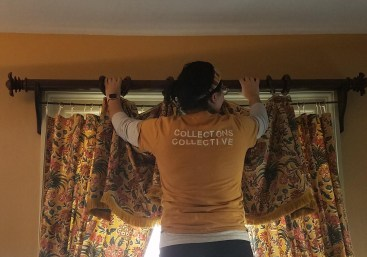 Collections Manager, Jenniffer, removing window hangings to allow the Architecture & Preservation team to conserve a window.